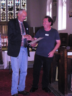 Albert being presented with his life membership by President Mike Robson