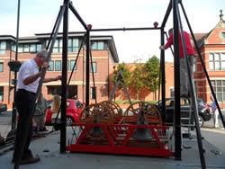 Our helping hands building the mobile belfry ready for the rush of visitors